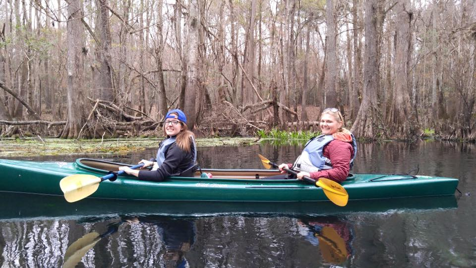 UF graduate students Meghan Mangrum, left, and Hannah O. Brown paddle North Florida's Ichetucknee River on a field trip for Environmental Journalism class.